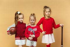 Happy and beautyful children show different sport. Studio fashion concept. Emotions concept. Stock Images