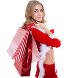 Happy beautyful woman in red santa claus clothes with shopping bags Stock Photos