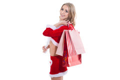 Happy beautyful woman in red santa claus clothes with shopping bags Royalty Free Stock Photo