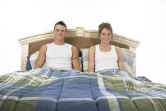 Happy in bed. Happy couple in the bedroom Royalty Free Stock Image