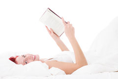 Happy in bed reading a book Royalty Free Stock Photo