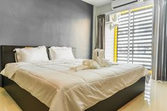 Happy bedroom and comfortable mattress and pillows royalty free stock photo