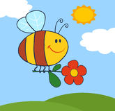 Happy bee flying with flower in sky Stock Photography