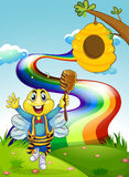 A happy bee at the hilltop with a rainbow Stock Photography