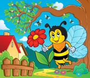 Happy bee holding flower theme 2 Royalty Free Stock Photo
