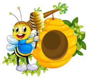 A happy bee playing with the honey near the beehive Royalty Free Stock Photo