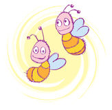 Happy bees. Two happy bees flying in top of yellow spiral Stock Image