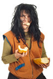 Happy beggar woman eating  bread Stock Photography