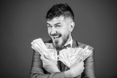 Happy being rich. Rich businessman with us dollars banknotes. Currency broker with bundle of money. Bearded man holding. Cash money. Making money with his own stock photo