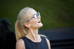 Happy bespectacled woman. Close up portrait of happy mature bespactacled woman Stock Images