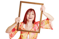 Woman holding empty frame in front Stock Photo