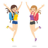 Happy Best Friends. Beautiful happy young students best friends girls jumping Royalty Free Stock Photography