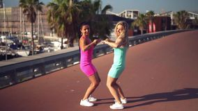 Happy best friends or sisters dancing and posing. And showing lovely relationship. They look happy. They have same stock video