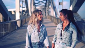 Happy best friends or sisters walking and talking. Showing lovely relationship. They look happy stock video footage