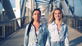 Happy best friends or sisters walking together. They look happy stock footage