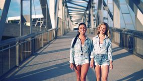 Happy best friends or sisters walking together. They look happy stock video