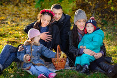 Happy Big Family in Autumn Park.Picnic. Happy Big Family in Autumn Park, picnic in lovely sunny day Royalty Free Stock Photos