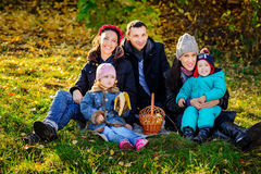 Happy Big Family in Autumn Park.Picnic. Happy Big Family in Autumn Park, picnic in lovely sunny day Stock Photo