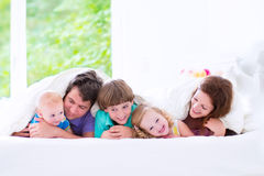 Happy big family in a bed stock photos