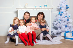 Happy big family hugging near Christmas tree. Royalty Free Stock Photo