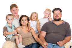 Happy big family sitting on sofa Stock Photos