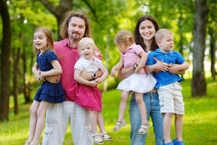 Happy big family of six at summer park Royalty Free Stock Photo