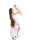 Happy big family! Young mother with two children daughters on white Royalty Free Stock Images