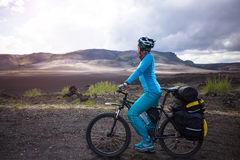 Happy biker on backdrop of volcanic mountains in Iceland Stock Photo