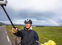 Happy biker doing selfie on backdrop of mountains in Iceland Stock Images