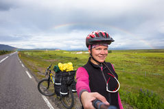 Happy biker doing selfie on backdrop of mountains in Iceland Stock Photos