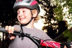 Happy Biker at Dusk Stock Photo