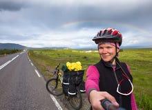 Happy biker make selfie on backdrop of her bike in Iceland Stock Images