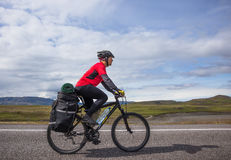 Happy biker ride on road in Iceland. Travel and sport picture Stock Photo