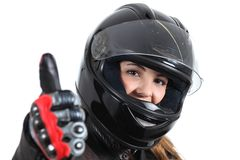 Happy biker woman with a road helmet and thumb up. Isolated on a white background Royalty Free Stock Photos