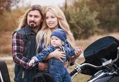 Happy family has a fun outdoor. Happy bikers family has a fun outdoor. Father`s Day concept. Mother`s Day concept. Family look stock photos