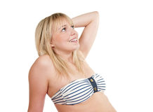 Happy bikini girl. Happy young blond bikini-girl stock photography