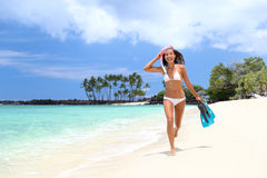 Happy bikini woman relaxing on white sand beach. Bikini woman happy having fun running on white sand beach with fins and snorkeling gear. Tropical vacation girl Royalty Free Stock Photography