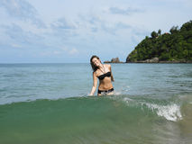 Happy Bikini Woman Walking In Water At Beach Stock Images