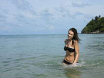 Happy Bikini Woman Walking In Water At Beach Stock Image