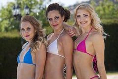 Happy bikini women stock images