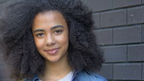 Happy biracial girl smiling on camera, teenager rights, international student. Stock footage stock video footage