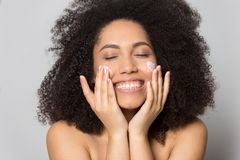 Free Happy Biracial Young Woman Preform Skincare Routine Stock Images - 160964214