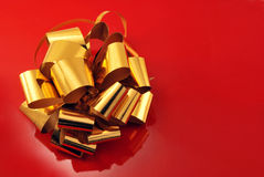 Happy birtday. Golden bow on a red background Stock Image