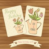 Happy birthaday cards in wood background. Gretting. Happy birthaday card in wood background. Gretting cards flowers bouquet in watercan. Pastel colour Stock Photo