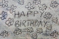 Happy birthay inscription on sand Stock Image