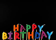 Happy Birthday!. Colorful happy birthday candles on black background Royalty Free Stock Photos
