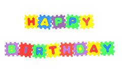 Happy Birthday. Message Happy Birthday from letter puzzle, isolated on white Stock Photos