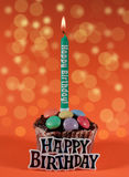 Happy birthday. Birthday cake and a candle on orange background Royalty Free Stock Photography