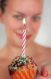Happy birthday. Young woman holding a small birthday cake Royalty Free Stock Photo