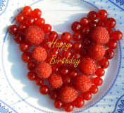 Happy Birthday. Wishes with red currant and raspberries Stock Image